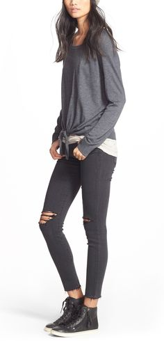 Currently crushing on this sporty fall look that pairs a cute sweater with distressed denim and high top sneakers.
