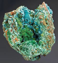 Colorful combinaton of blue Rosasite on green Malachite in a matrix vug! This concave structure of the matrix has served to protect the botryoidal surfaces of both minerals from contacting and bruising. The Rosasite flows deep into the upper portion of the vug while the satiny Malachite fills the lower portion.  From the Ojuela Mine, Mapimi, Durango, Mexico. Measures 7.5 cm by 6.5 cm by 7 cm in total size. Price $685