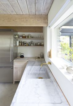marble counter & integrated sink, limed cabinet finish