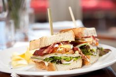 Gourmet prosciutto, smoked cheese and egg club sandwich (olivemagazine. Smoked Cheese, Salad Sandwich, Mediterranean Recipes, Prosciutto, Greek Recipes, Pain, Lunches, Cobb Salad, Sandwiches