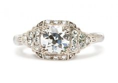 Canaan is a classic Art Deco engagement ring featuring a 0.98ct Old European Cut diamond with E color in a geometric setting. Very Gatsby! TrumpetandHorn.com | $10,600