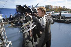 BTS shot of Sam Claflin as Finnick Odair with his trusty tripod