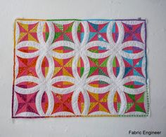 Metro Rings rainbow quilt by Fabric Engineer: 2015 Blogger's Quilt Festival. The Metro Rings pattern is by Sew Kind of Wonderful.