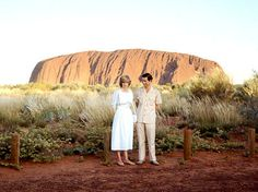 PRINCE CHARLES AND DIANA STANDING IN FRONT OF AYERS ROCK DURING THEIR OFFICIAL TOUR OF AUSTRALIA