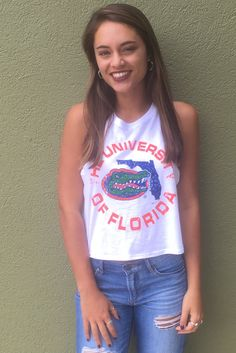 a71284afa7 Tops and tees. White racerback cropped tank top with Florida gator logo.