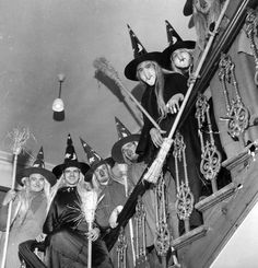 STAIRCASE OF WITCHES: A group of men in costume as witches, complete with brooms, to celebrate Halloween, lined the staircase of a house. photo by George Pickow/Getty Images Retro Halloween, What Is Halloween, Halloween Fotos, Halloween History, Vintage Halloween Photos, Halloween Prints, Halloween Pictures, Vintage Photos, Happy Halloween