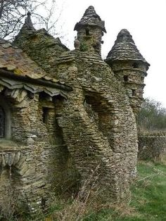 """Abandoned and decayed """"Hobbit House"""" built by Colin Stokes in Chedglow, Wiltshire, England. The Hobbit House was a sheep shed built without permission by a local artist, the sprawling construction took nearly ten years to build. Abandoned in the Abandoned Buildings, Abandoned Castles, Abandoned Mansions, Old Buildings, Abandoned Places In The Uk, Modern Buildings, Interesting Buildings, Beautiful Buildings, Beautiful Places"""