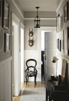 Days: Inspiring Silver Rooms grey walls with white wainscoting - I could do without the more rustic elements, but everything else I love.grey walls with white wainscoting - I could do without the more rustic elements, but everything else I love. Wainscoting Hallway, Wainscoting Styles, Wainscoting Nursery, Wainscoting Kitchen, Wainscoting Height, Painted Wainscoting, Wainscoting Panels, Beadboard Wainscoting, Hallway Wallpaper