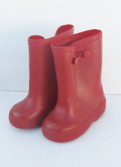 1950's Rubber Boots ... oh how I hated wearing these!!!  they rubbed the back of your legs till they were raw... we wore skirts and short socks...no pants ! (yet)