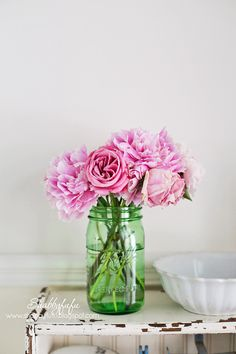 Peonies in a mason jar look beautiful on top of a DIY bead board shelf made from old wood. | Shabbyfufu