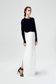 Shop this look on Lookastic: http://lookastic.com/women/looks/black-crew-neck-sweater-and-white-lace-maxi-skirt-and-black-leather-sandals/2906 — Black Crew-neck Sweater — White Lace Maxi Skirt — Black Leather Heeled Sandals