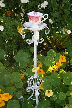 Heavy and tall rod iron candle holder and a pretty tea cup and saucer for a bird feeder. Garden Crafts, Garden Projects, Teacup Crafts, Iron Candle Holder, Glass Flowers, Flower Plates, Cute Birds, Glass Garden, Yard Art