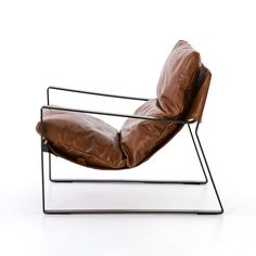 Your next favorite read is calling your name with the comfortable Four Hands Emmett Sling Chair . The sling leather seat has a plush cushion that will. Industrial Chair, Vintage Industrial Furniture, Metal Chairs, Cool Chairs, Blue Chairs, Leather Chairs, White Chairs, Leather Accent Chairs, Leather Lounge