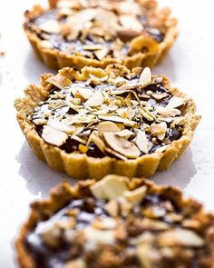 These Gluten-Free Chocolate Almond Tartlets have an almond flour and shredded coconut crust that gets filled with a creamy and rich non-dairy chocolate ganac. Toasted Almonds, Toasted Coconut, Lemon Coconut, Gluten Free Chocolate, Homemade Chocolate, Chocolate Ganache Filling, Chocolate Cheesecake, Lemon Cheesecake, Chocolate Desserts