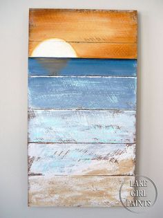 Beach art painted on boards.