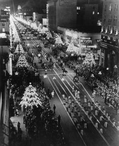 Vintage Hollywood Holiday: - 1945 view looking down upon Hollywood Blvd. from the east on the eve of the annual Santa Clause Lane Parade (now called the Hollywood Christmas Parade). Christmas decorations can be seen on the festively lit boulevard.