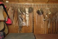 Keep dust off tack hanging up in the tack room with a clear shower curtain!  Genius!