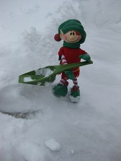 Christopher Pop-In-Kins gives some elf support to clear the snow-covered sidewalk. Elf Fun with Pop-In-Kins