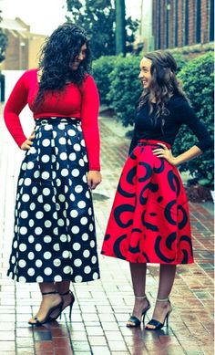 Azel: Empire waist tea length skirt with polka dot print and elastic waist fits one size S-L in black and white