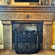 Cast concrete fireplace painted with Modern Masters Statuary Bronze, Brass, Pale Gold, and Champagne Metallic Paints | Project by Katie Gaines of Love Paper Paint