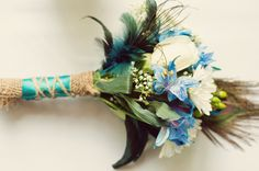 teal, peacock themed DIY bouquet from Gabrielle & Marc's budget-friendly, personalized peacock themed Maryland wedding. Images by You Are Raven Photography.