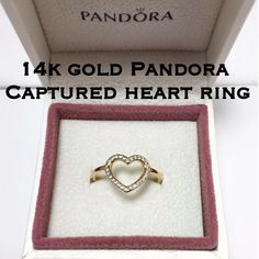 Authentic Pandora ALE 14k Gold Captured Heart Ring This is a New In Box Authentic Pandora ALE 14k Solid Yellow Gold Captured Heart With Cubic Zirconias Ring. Size 7. Marked inside band: G585 ALE 54. This is a beautiful ring and would make a great gift! Valentine's Day is right around the corner! Price is firm, selling for my twin sis. Comes with box shown in pictures! Never worn! Save $100! Thanks for stopping by my closet! I appreciate your interest! I ship out same day! Please ask any…