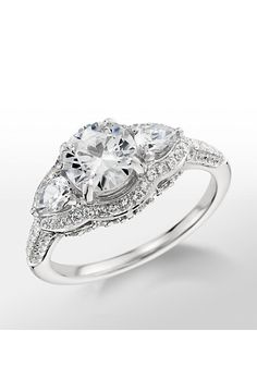 Brides.com: . Style 44078, three stone diamond engagement ring in platinum, $2,670 (center stone not included), Monique Lhuillier available exclusively at Blue Nile