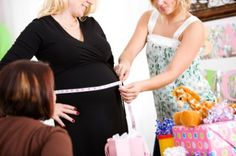 ask guests to cut a piece of ribbon or string that they think will be fit around the mother's belly and see who's idea is closest one and give her a gift.