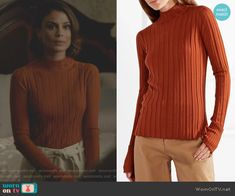 Cristal's orange ribbed sweater and leather coat on Dynasty. Outfit Details: https://wornontv.net/82804/ #Dynasty