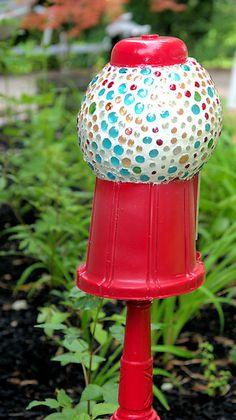 Gum ball machine! would look cute in a garden!