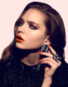 """""""Amazing. Orange lips."""" Brown hair, tanned face. Personal Trend. Dec 13. L."""