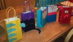 Goodie bags for little mermaid themed bday party!  Flounder, Ursula, Ariel, Prince Eric, Sebastian