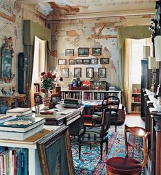 A study in Laura di Collobiano and Moreno Petrini's villa at their Tuscan vineyard, Tenuta di Valgiano; murals are of classical ruins; photo by Oberto Gigli