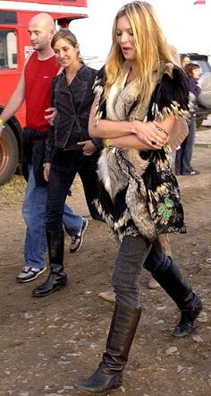 Kate reverted back to her boho status in boots and a fur gillet at Glastonbury Festival in June 2004.