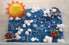 """Weather"" Sensory Tub - Blue aquarium rocks (sky), cotton balls (clouds), shiny pipe cleaners (lightning bolts!), blue beads (rain), snowflake manipulatives, felt sun (could use yellow spiky jelly-ball or small tennis ball)"