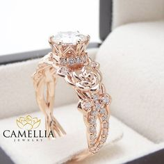For impeccable style, you simply cannot go wrong with this 14K rose gold Moissanite engagement ring from Camellia Jewelry. Hand-forged in stunning detail, the mounting resembles a flower deco as it elevates the floral accents and sparkling Moissanite stone in luminous detail. Dainty