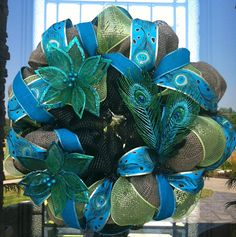 Glittered Peacock Turquoise deco mesh Wreath. $90.00, via Etsy.