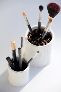 Add coffee beans to your makeup brush holders. Makes them easy to grab...and it looks cute.