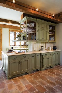 white kitchen cabinets with green walls mediterranean kitchen cabinets olive green sage green kitchen Distressed Kitchen Cabinets, Antique Kitchen Cabinets, Kitchen Cabinets Pictures, Cottage Kitchen Cabinets, Kitchen Cabinet Colors, Painting Kitchen Cabinets, Kitchen Decor, Kitchen Rustic, Mediterranean Kitchen Cabinets