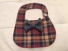(bow tie fabric may vary)This listing is for one bib,size large These are great bibs, the bow ties snap on and off so you can remove when eating and snap it back on after. ( machine wash, lay flat to dry)pearl snaps hold strong, babies have a real hard time pulling these off.made of recycled materials.  Size chart X-small: 7.5x 9 11 neck opening Small: 9x 10.3/4 12 neck opening Medium: 9.5x11.5 13 neck opening Large: 10.5 x 12.5 14.5 neck opening