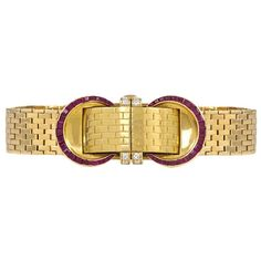 John Rubel Ladies Yellow Gold Diamond Ruby Covered Wristwatch   From a unique…