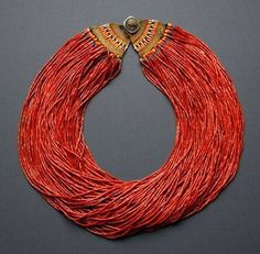 Multi-strand glass bead necklace (93 strands!). Nagaland (India): Naga people, mid-20th c. Diam. (as shown) approx. 31 cm. Glass beads, woven cotton ends, King George VI coin. Shown in Truus Daalder, *Ethnic Jewellery and Adornment*, p. 339. Collection Truus and Joost Daalder. ( Joost Daalder)