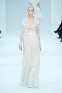 If I was that skinny, had enough money, and someplace to go that this may be even vaguely appropriate to wear to...I'd need to own probably everyone on of the Elie Saab Spring Couture 2012 dresses. They make me want to give up my sweatpants without a second though.