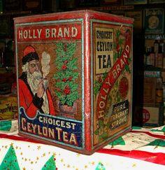 Holly Brand Choicest Ceylon Tea tin, with artwork of Father Christmas or Santa Claus smoking pipe and Christmas holly and berry garland, c. Berry Garland, Tea Brands, Tea Tins, Santas Workshop, Vintage Cookies, Tea Box, Vintage Tins, Father Christmas, Tin Boxes