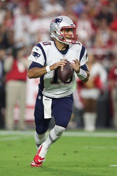 Jimmy Garoppolo Photos Photos - Quarterback Jimmy Garoppolo #10 of the New England Patriots drops back to pass during the NFL game against the Arizona Cardinals at the University of Phoenix Stadium on September 11, 2016 in Glendale, Arizona. The Patriots defeated the Cardinals 23-21. - New England Patriots v Arizona Cardinals
