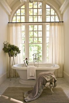 """""""McAlpine Booth & Fer charisma design."""" huge window over tub with sheers"""