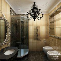 Ванная комната в стиле арт-деко отличается роскошью и изяществом. Золотистого цвета плитка, тёмная - на полу, зеркала в изящном обрамлении , белый потолок и готическая люстра создали мистический и загадочный интерьер.