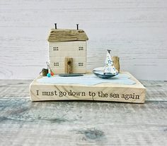 Check out this item in my Etsy shop https://www.etsy.com/uk/listing/538120213/beach-house-driftwood-art-wood-house