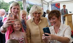 Double the selfie, double the fun! Camilla, Duchess of Cornwall posed for two photos at once during her visit to Poppy Pod Village at the Tile Barn Outdoor Centre.