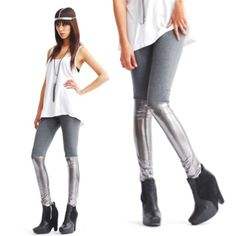 Two Tone Eco Leather Gray + Gunmetal Leather Panel Leggings Contrasting Metallic + Matte  Grey Cotton Spandex Upper W/ Gunmetal Metallic Faux Leather Coated Spandex Lower  High Waist Comfortable  Charcoal Upper Cotton Spandex Blend Fabric  Silver Metallic Grey Shiny Eco Leather Faux Pu Coated Stretch Spandex Lower Panel  Full Length Fitted Stretch Pants  Lifestyle Activities + Fitness With  The Look Of Layering Leather Socks Over  Futuristic Minimalist  Animal Cruelty Free : Vegan